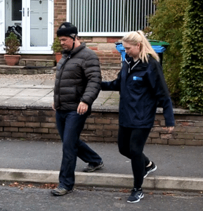 Physio Erin assisting Andy to walk