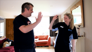 Physio Erin high-fiving Andy