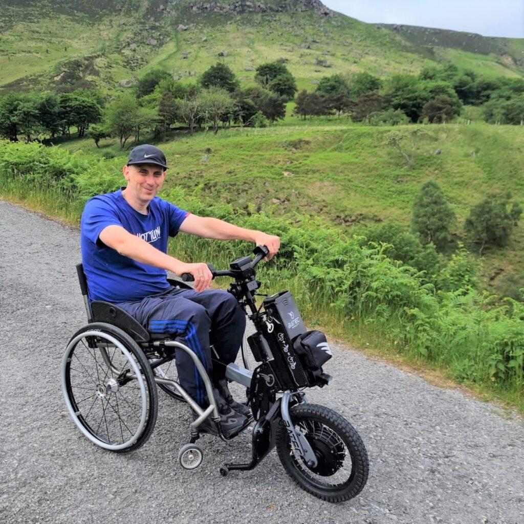 Physio Matters client John using handbike adaptation for wheelchair